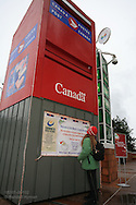 Girl admires world's largest mailbox (Guinness World Records) in downtown Vancouver, British Columbia, Canada.