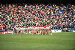 Mayo standing for the anthem before the quarter final against Cork.<br />Pic Conor McKeown