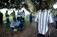 Samuel Ogwal, 30, prays with neighbors in their little village in northern Uganda. Ogwal, as a young boy, was abducted by the LRA (Lord's Resistance army) and was  forced to teach children to kill and to watch them die, to deliver beatings and conduct ritualistic murders -- he was now facing a new kind of terror: returning home to the uncertain judgment of family and friends who had been brutalized by rebels like him.  (PHOTO: MIGUEL JUAREZ LUGO).