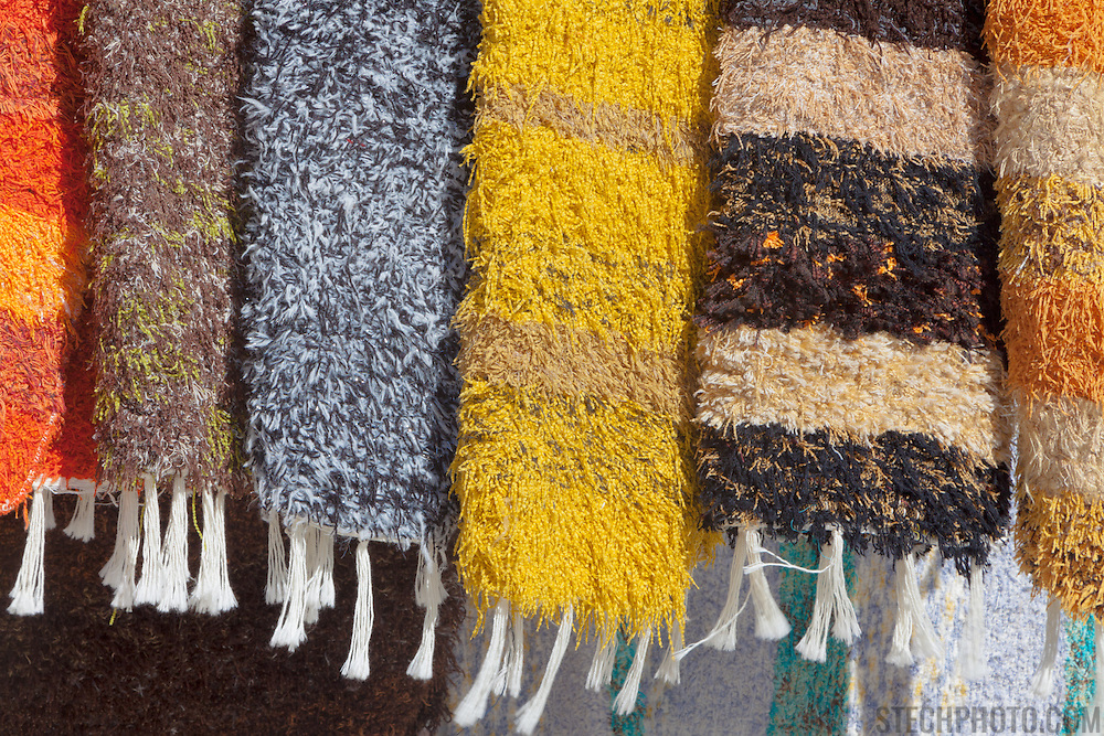 Rugs for sale at a market in Alpujarra de la Sierra (Almeria, Andalucia, Spain).