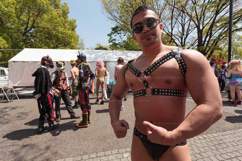 A muscular gay man poses at The Rainbow Pride Event in Yoyogi Park, Shibuya, Tokyo, Japan. Sunday, April 26th 2015. This is the forth annual celebration of LGBT issues in Tokyo and forms part of a wider Rainbow Week. About 5% of the Japanese population identify as homosexual and this event hopes to foster a society where they can live equally and without prejudice.
