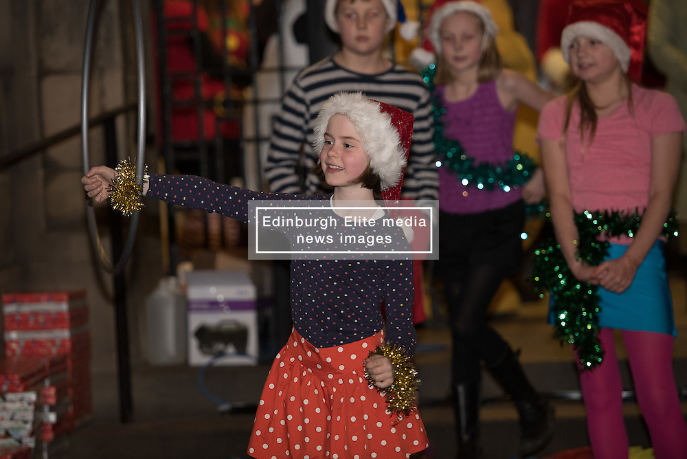 Edinburgh council may have cut the budget for Christmas street lights in various Edinburgh communities but the people of Portobello didn't let that dampen their spirits last night as they celebrated turning on the Christmas Tree lightsin front of Portobello Town Hall.<br /> © Jon Davey/ EEm Edinburgh council may have cut the budget for Christmas street lights in various Edinburgh communities but the people of Portobello didn't let that dampen their spirits last night as they celebrated turning on the Christmas Tree lights in front of Portobello Town Hall.<br />