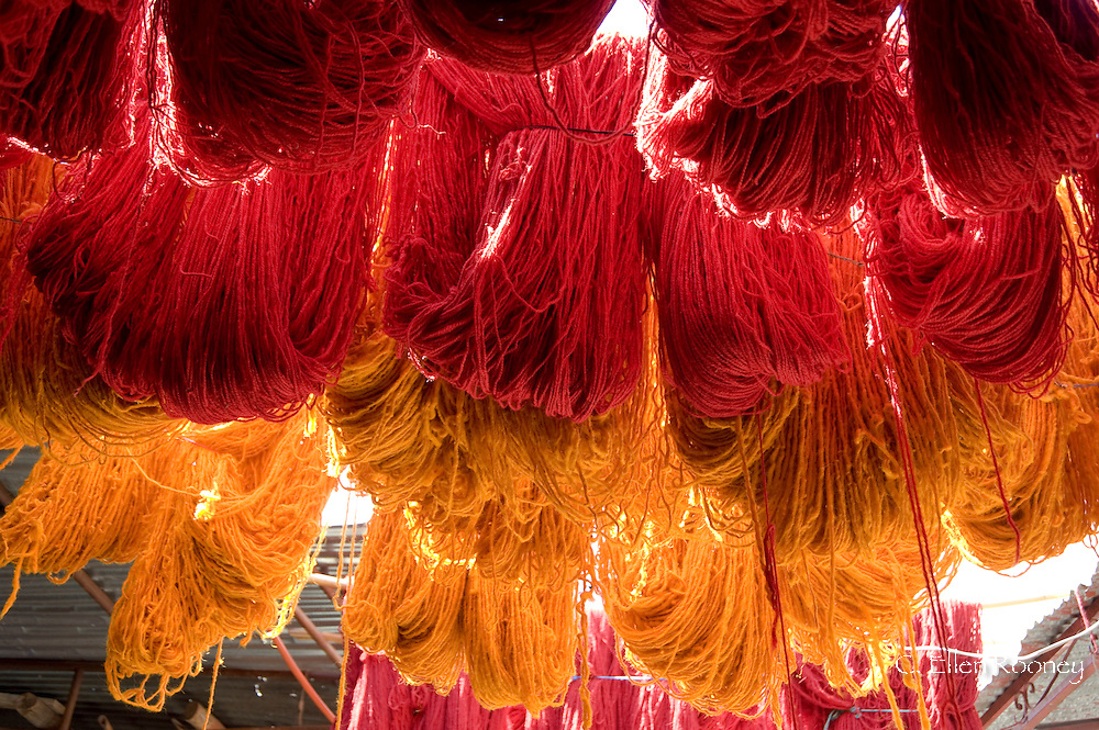 Brightly coloured wool hanging to dry in the dyers souk, Marrakech, Morocco