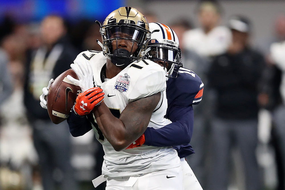 Auburn Tigers defensive back Stephen Roberts (14) breaks up a pass intended for UCF Knights wide receiver Marlon Williams (17) during the 2018 Chick-fil-A Peach Bowl NCAA football game on Monday, January 1, 2018 in Atlanta. (Jason Parkhurst / Abell Images for the Chick-fil-A Peach Bowl)