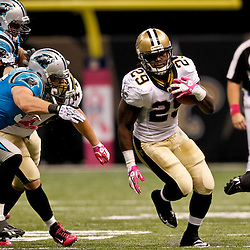October 3, 2010; New Orleans, LA, USA; New Orleans Saints running back Chris Ivory (29) runs away from Carolina Panthers linebacker Dan Connor (55) during the second quarter at the Louisiana Superdome. Mandatory Credit: Derick E. Hingle