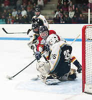 Caleb Drouin's shot gets blocked by Kennett goalie Josh Kondrat during NHIAA Division III quarterfinal game at the Laconia Ice Rink Saturday evening.  (Karen Bobotas/for the Laconia Daily Sun)