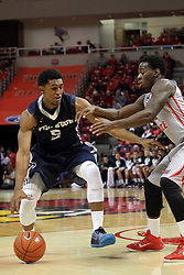 16 November 2014: Julion Pearre works the dribble against Daishon Knight  during an NCAA non-conference game between the Utah State Aggies and the Illinois State Redbirds.  The Aggies win the competition 60-55 at Redbird Arena in Normal Illinois.
