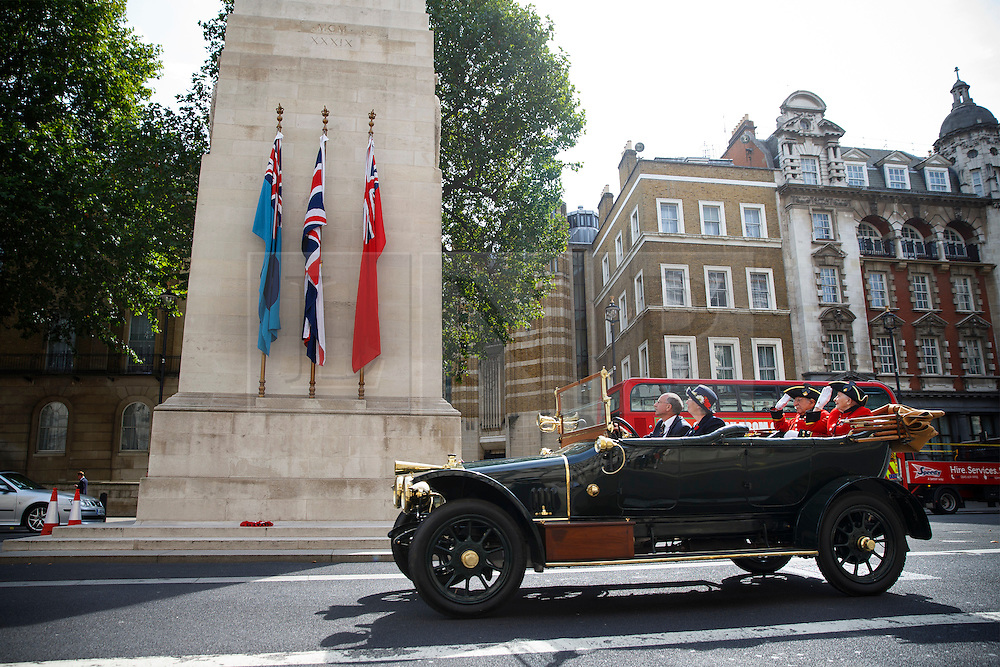 © Licensed to London News Pictures. 04/08/2014. LONDON, UK. Chelsea pensioners driving past the Cenotaph as they take part in The Great War Centenary Parade, a procession of over 40 Edwardian cars, all of which would have been on the road during the Great War. The procession marks the 100th year since Great Britain declared war on Germany in WW1. Photo credit : Tolga Akmen/LNP