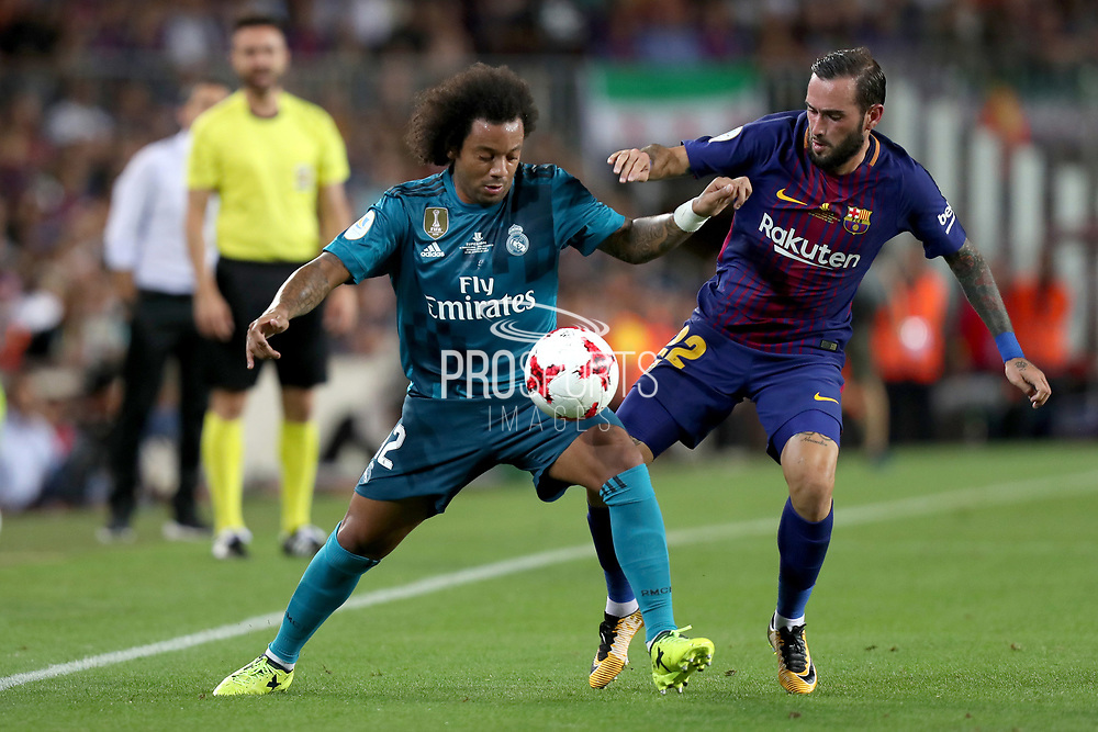 Marcelo of Real Madrid duels for the ball with Aleix Vidal of FC Barcelona during the Spanish Super Cup football match between FC Barcelona and Real Madrid on August 13, 2017 at Camp Nou stadium in Barcelona, Spain. - Photo Manuel Blondeau / AOP Press / ProSportsImages / DPPI
