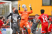 Lincoln City goalkeeper Matt Gilks handles a cross into the box in the first half during the EFL Sky Bet League 2 match between Crawley Town and Lincoln City at The People's Pension Stadium, Crawley, England on 23 March 2019.