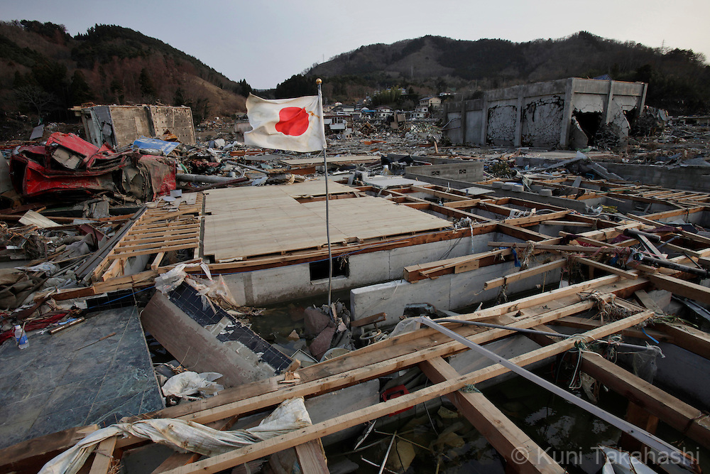 A Japanese flag is hoisted on debris in Onagawa, Miyagi, Japan on April 2, 2011 after massive earthquake and tsunami hit northern Japan. More than 20,000 were killed by the disaster on March 11.<br /> Photo by Kuni Takahashi