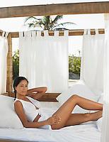 Woman Relaxing in Outdoor Bed
