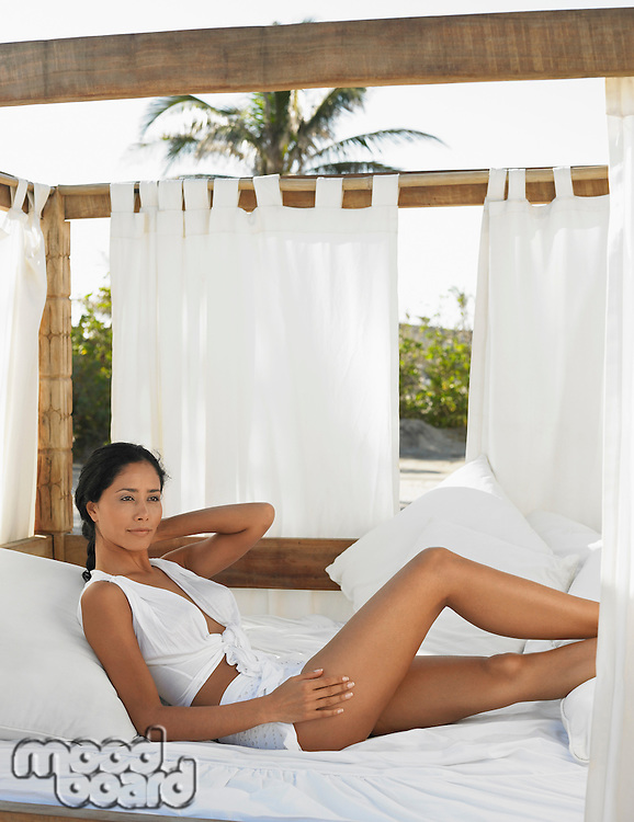 Woman Relaxing in Outdoor Bed