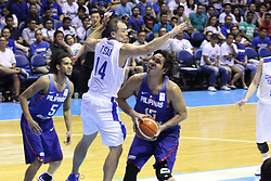 November 27, 2017 - Quezon City, NCR, Philippines - Junemar Fajardo (15) of the Philippines tries to shoot the ball over Wen-Cheng Tsai (14) of Chines Taipei during their FIBA World Cup Qualifying Match..Gilas Pilipinas defeated the visiting Chinese Taipei team 90-83 to complete a sweep of their first two assignments in the FIBA 2019 World Cup qualifiers. (Credit Image: © Dennis Jerome S. Acosta/Pacific Press via ZUMA Wire)