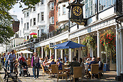 Street scene at The Pantiles pedestrian area of Tunbridge Wells with pavement cafes and shops in Kent, England, UK