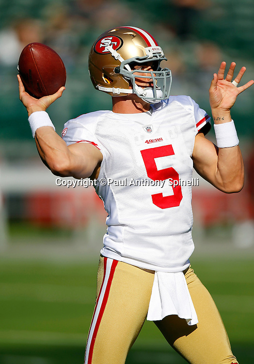 San Francisco 49ers quarterback David Carr (5) throws a pregame pass during the NFL preseason week 3 football game against the Oakland Raiders on Saturday, August 28, 2010 in Oakland, California. The 49ers won the game 28-24. (©Paul Anthony Spinelli)