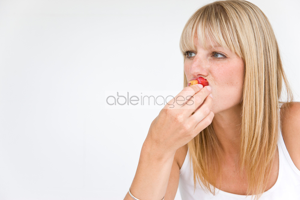 Woman Eating Plum