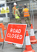 © Licensed to London News Pictures. 18/07/2012. Westminster, UK. A soldier at a gate in St James Park. Soldiers, police and security contractors perform security checks around Olympic sites in Westminster today, 18th July 2012. Photo credit : Stephen Simpson/LNP
