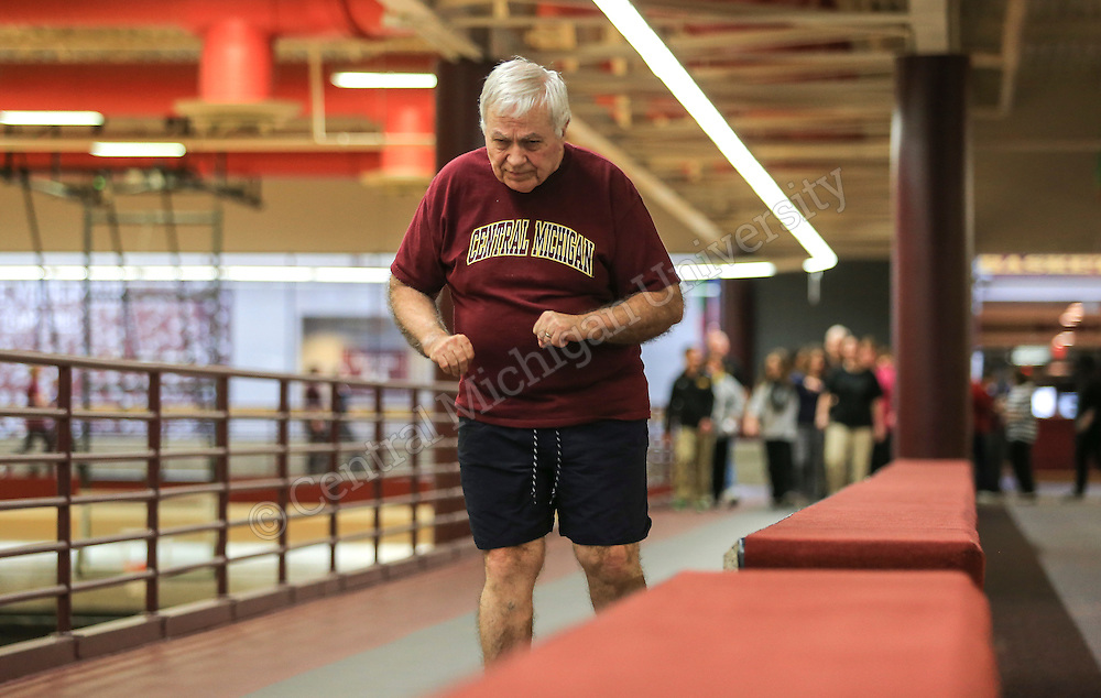 Faculty and staff participate in Poker Walk<br /> Teams of CMU faculty and staff put on their walking shoes and participated in the annual Poker Walk, sponsored by CMU Employee Wellness Program. They earned prizes for the number of laps walked around the indoor track in the Student Activity Center. Photos by Steve Jessmore/Central Michigan University