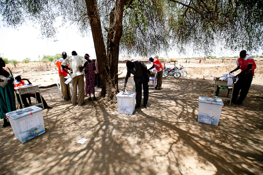 "A returning ""lost boy"" votes in Sudan's historic elections in Bor."