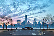 "Smoke from a recent forest fire in Southern New Jersey created a unique atmosphere which I find is responsible for the unique aesthetic of this image. In the foreground ther is a memorial to the September 11 attacks while in the background One World Trade Center, briefly dubbed ""Freedom Tower"" stands tall."