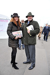 CHARLIE & REBEKAH BROOKS at the Hennessy Gold Cup at Newbury Racecourse, Berkshire on 26th November 2011.