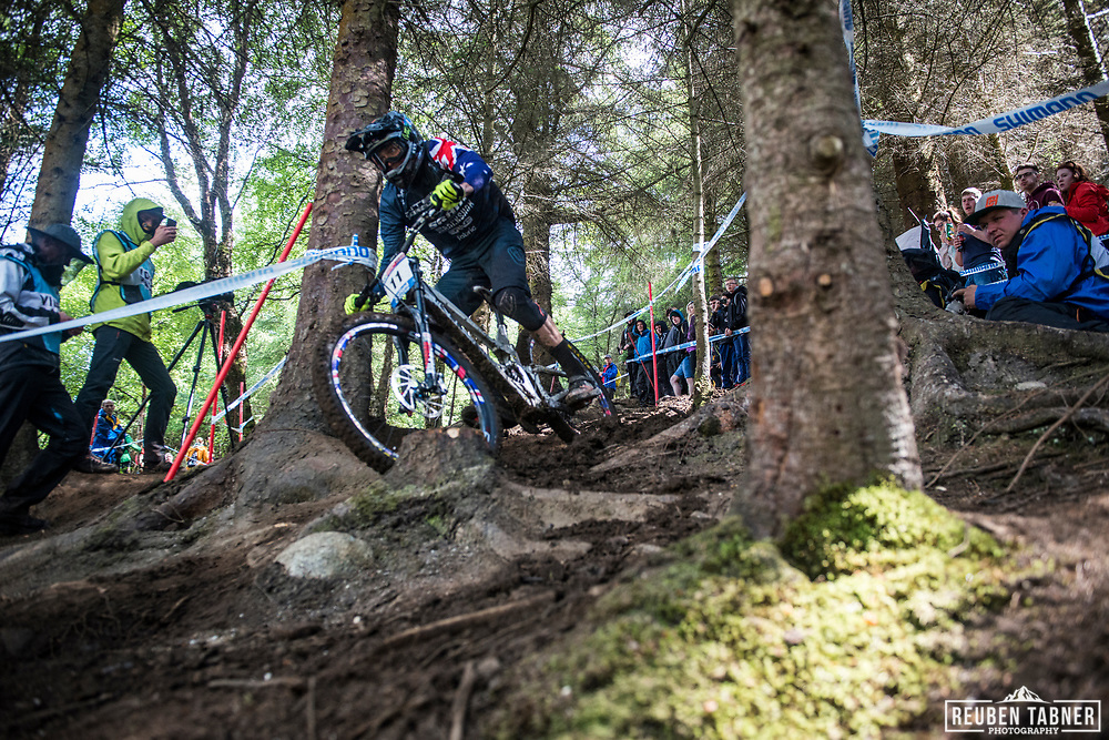Jack Moir finding his way in through the woods during his qualifying round at the UCI Mountain Bike World Cup in Fort William, Scotland.
