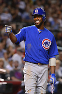 PHOENIX, ARIZONA - APRIL 08:  Dexter Fowler #24 of the Chicago Cubs smiles and points to the umpire while at bat against the Arizona Diamondbacks at Chase Field on April 8, 2016 in Phoenix, Arizona.  (Photo by Jennifer Stewart/Getty Images)