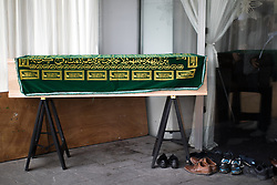 © Licensed to London News Pictures . 12/05/2017 . Manchester , UK . The coffin . Thousands of people fill a mosque , inside a marquee at the British Muslim Heritage Centre in Whalley Range , Manchester , for the funeral of Mawlana Habib-ur-Rahman , at the British Muslim Heritage Centre , Whalley Range , Manchester . Rahman , a former maths teacher and then imam at Manchester Central Mosque , died aged 90 following heart problems . As a well-known leader of Manchester's Muslim community he promoted interfaith dialogue and met the Pope during a Papal visit to Manchester in 1982 . Due to the number attending , crowds attending the funeral had to be diverted to rooms in nearby buildings to listen to the service via loudspeaker . Photo credit : Joel Goodman/LNP