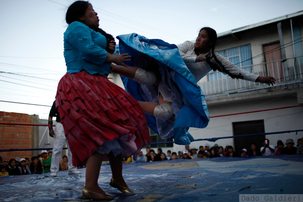 Wrestler Carmen Rosa, Yolanda and Julia la Paceña fight at ring set on a courtyard of a house in La Paz, Bolivia, Saturday, July 3, 2010.