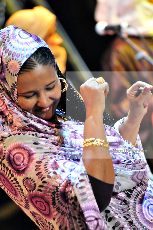 "Fadimata Walett Oumar, Tartit, dances during Nabil Othmani's concert at the ""III Rencontre Internationale d'Imzad"" in  Tamanrasset."