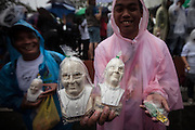 Busts of Pope Francis were sold in the streets, although not all of them look much like him. Despite it raining all day, between six and seven million people turned out for a mass by Pope Francis in Rizal Park in Manila.