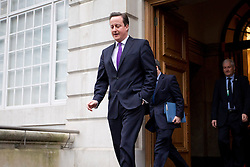 © Licensed to London News Pictures. 23/01/2013. London, UK. The British Prime Minister, David Cameron, leaves the headquarters of financial news corporation Bloomberg in London today (23/01/13) after giving a keynote speech on Britain's future in Europe. The prime minister was expected to call for the terms of Great Britain's membership of the union to be re-negotiated. Photo credit: Matt Cetti-Roberts/LNP