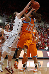 Dec 20, 2011; Stanford CA, USA;  Stanford Cardinal forward Bonnie Samuelson (left) blocks a shot by Tennessee Lady Volunteers guard Meighan Simmons (10) during the first half at Maples Pavilion.  Mandatory Credit: Jason O. Watson-US PRESSWIRE