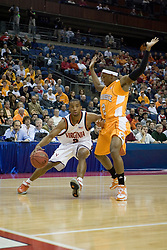 Virginia Cavaliers guard J.R. Reynolds (2) dribbles around Tennessee Volunteers guard JaJuan Smith (2).  Reynolds scored 22 first half points (26 total) in his final collegiate game.  The #4 seed Virginia Cavaliers were defeated by the #5 seed Tennessee Volunteers 77-74 in the second round of the Men's NCAA Tournament in Columbus, OH on March 18, 2007.