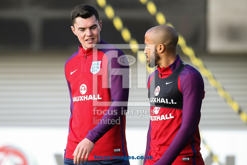 Michael Keane (Burnley) (left) chats with Andros Townsend (Crystal Palace) (right) during the England training session at St Georges Park, Burton upon Trent<br /> Picture by Andy Kearns/Focus Images Ltd 0781 864 4264<br /> 04/10/2016