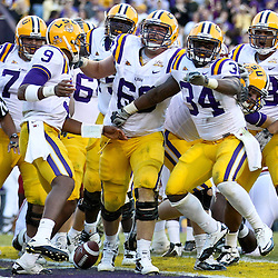 November 6, 2010; Baton Rouge, LA, USA;  LSU Tigers running back Stevan Ridley (34) celebrates with teammates following a touchdown against the Alabama Crimson Tide during the second half at Tiger Stadium. LSU defeated Alabama 24-21.  Mandatory Credit: Derick E. Hingle