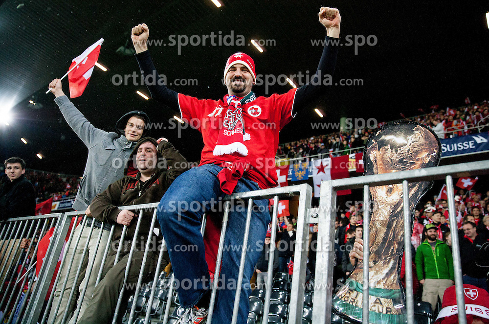 Fans of Switzerland celebrate after the FIFA World Cup 2014 Group E qualification match between Switzerland and Slovenia on October 15, 2013 in STADE DE SUISSE, Bern, Switzerland. Switzerland defeated Slovenia 1-0 and Qualified for World Cup Brasil 2014. (Photo by Vid Ponikvar / Sportida)