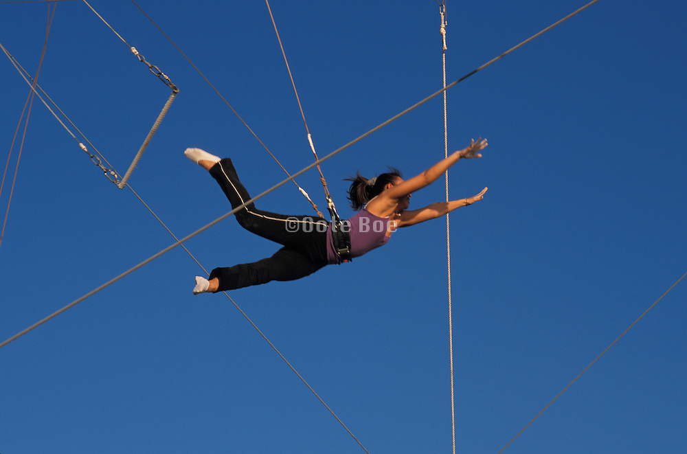 Trapeze acrobat practicing for her act