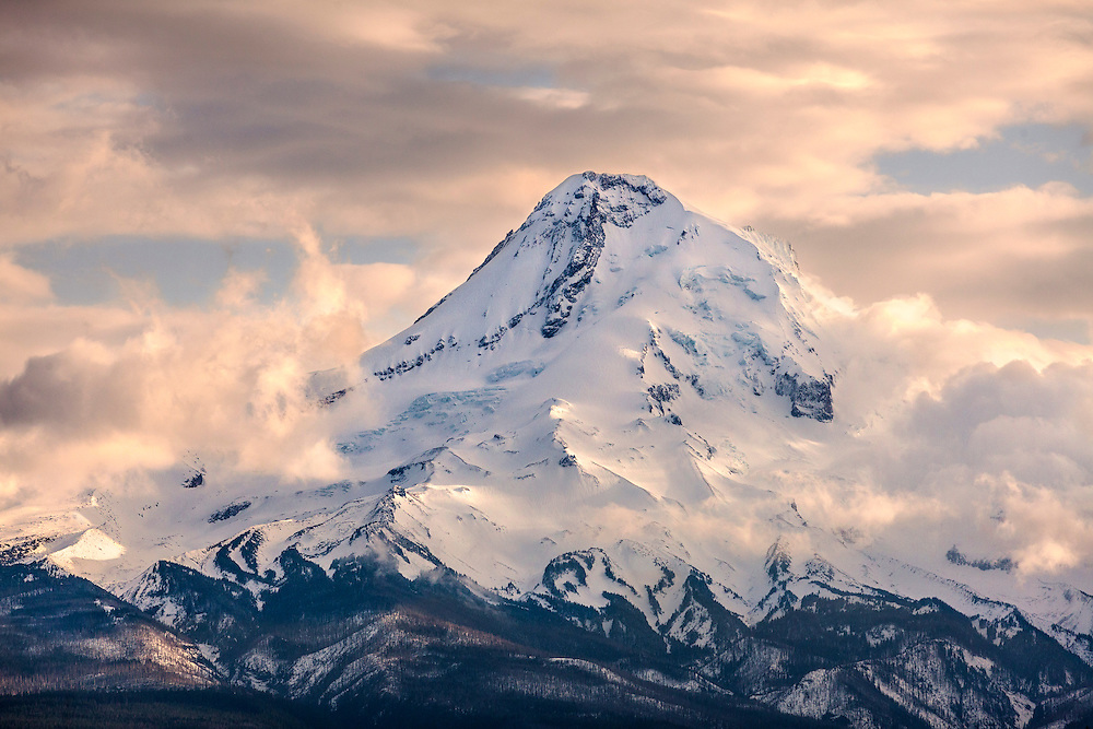 Clearing storm clouds reveal the north face of Mt. Hood, Oregon's highest mountain.