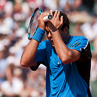 1 June 2009: Jo Tsonga of France looks dejected during the Men's Single Fourth Round match on day nine of the French Open at Roland Garros in Paris, France.