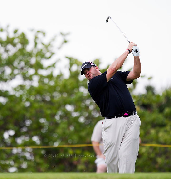 Jason Gore follows through his swing after teeing off on the 5th hole during the final round of the 2012 Price Cutter Charity Championship at Highland Springs Country Club on August 12, 2012 in Springfield, Missouri. (David Welker/www.TurfImages.com).
