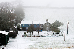 © Licensed to London News Pictures. 09/11/2019. New Radnor, Powys, Wales, UK. A wintry landscape at Llanfihangel-nant-Melan on the A44 in Powys, Wales, UK. After a cold night with temperatures dropping to below zero degrees C and a frosty early morning start to the day, snow falls on some high land in Powys and the valleys get some heavy rainfall during the morning. UK.Photo credit: Graham M. Lawrence/LNP