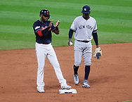 October 11, 2017 - Cleveland, OH, USA - The Cleveland Indians' Austin Jackson applauds after reaching second base on a Jay Bruce single as New York Yankees shortstop Didi Gregorius looks on in the fifth inning during Game 5 of the American League Division Series, Wenesday, Oct. 11, 2017, at Progressive Field in Cleveland. (Credit Image: © Leah Klafczynski/TNS via ZUMA Wire)