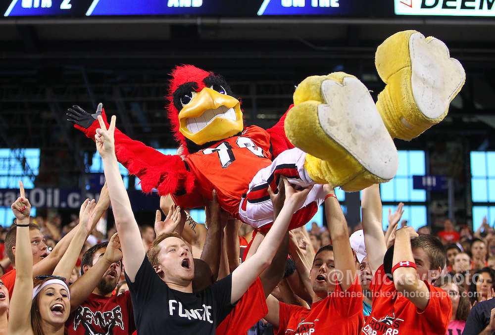 Sept. 03, 2011; Indianapolis, IN, USA; Ball State Cardinals mascot Charlie Cardinal is lifted in the stands during the game against the Indiana Hoosiers at Lucas Oil Stadium. Mandatory credit: Michael Hickey-US PRESSWIRE