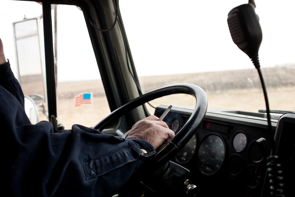 """Dwayne """"Bounce"""" Allen drives a truck load of corn to an ethanol plant on Wednesday, November 30, 2011 in Webster City, IA."""