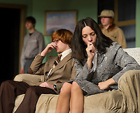 """John Hammond as Phillip Lombard and Vicki Vazquez as Lady Laura Joann Wargrave during dress rehearsal for Laconia High School's production of  """"And Then There Were None...""""  Wednesday evening.  (Karen Bobotas/for the Laconia Daily Sun)"""