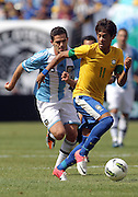 JUNE 09 2012:   Fernando Gago (5) of Argentina chases after Neymar (11) of Brazil during an international friendly match at Metlife Stadium in East Rutherford,New Jersey. Argentina won 4-3.