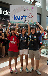 SINGAPORE, SINGAPORE - Sunday, July 17, 2011: Three Liverpool supporters show their devotion to Dirk Kuyt during an Adidas sponsored event at the Adidas store in the Marina Bay Sands Shopping Centre on day seven of the club's preseason Asia Tour. (Photo by David Rawcliffe/Propaganda)