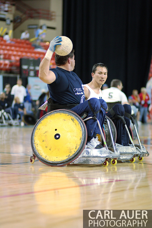 July 7th, 2006: Anchorage, AK - Scot Severn (blue) looks to pass as William Groulx plays tight defense as White defeated Blue in the gold medal game of Quad Rugby at the 26th National Veterans Wheelchair Games.